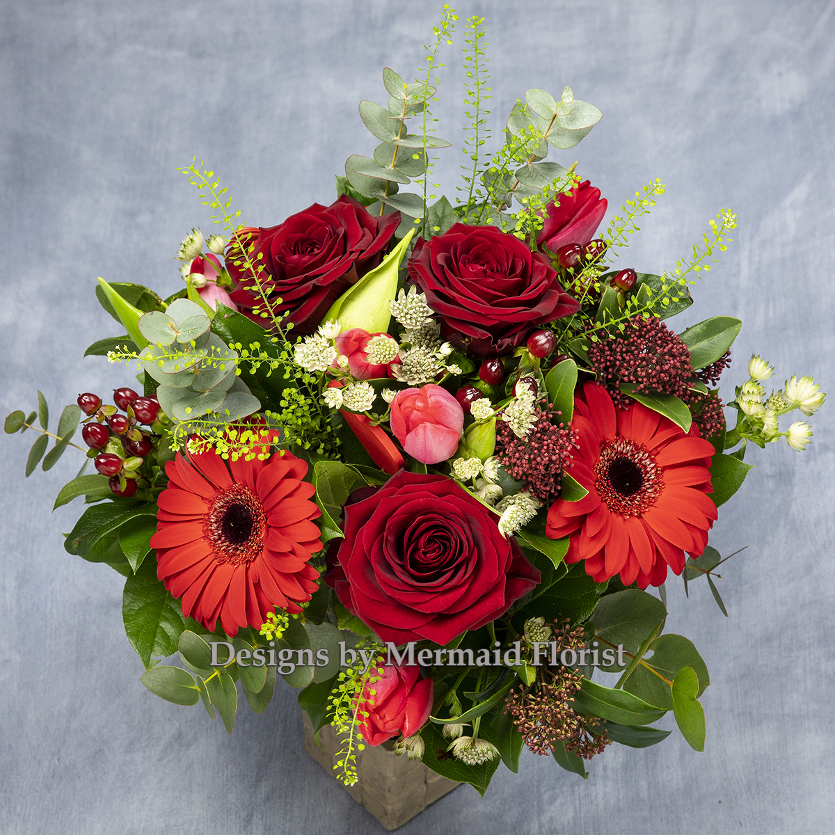 Red rose and red gerbera handtied bouquet